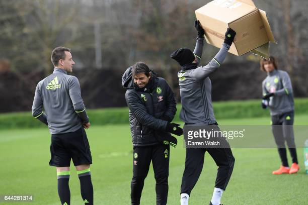 Diego Costa of Chelsea with a cardboard box with John Terry and Antonio Conte before a training session at Chelsea Training Ground on February 23...