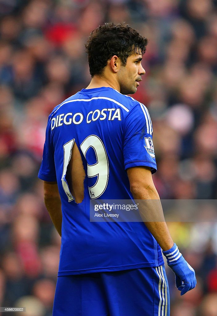 Diego Costa of Chelsea's shirt is ripped during the Barclays Premier League match between Liverpool and Chelsea at Anfield on November 8, 2014 in Liverpool, England.