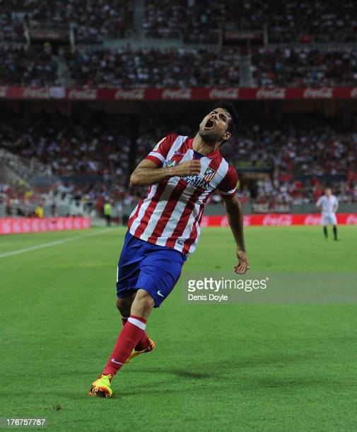 Diego Costa of Club Atletico de Madrid celebrates after scoring Atletico's 2nd goal during the La Liga match between Sevilla FC and Club Atletico de...