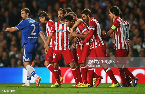 Diego Costa of Club Atletico de Madrid celebrates his goal with team mates during the UEFA Champions League semifinal second leg match between...