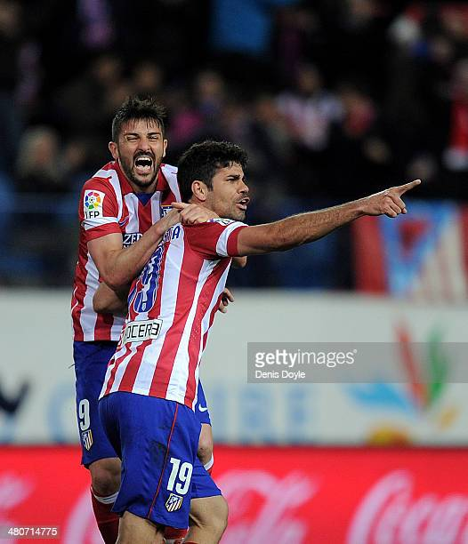 Diego Costa of Club Atletico de Madrid celebrates with David Villa after scoring his team's opening goal during the La Liga match between Club...