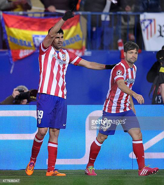 Diego Costa of Club Atletico de Madrid celebrates with Diego after scoring his team's fourth goal during the UEFA Champions League Round of 16 2nd...