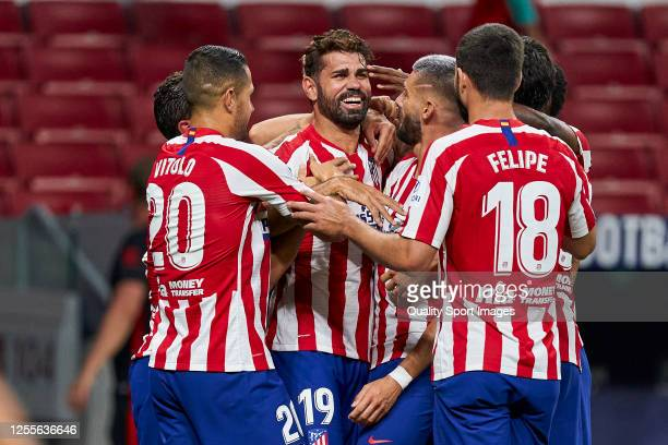 Diego Costa of Club Atletico de Madrid celebrates with teammates after scoring his team's first goal during the Liga match between Club Atletico de...