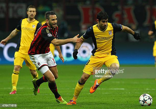 Diego Costa of Club Atletico de Madrid is challenged by Adil Rami of AC Milan during the UEFA Champions League Round of 16 match between AC Milan and...