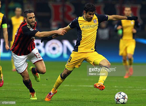 Diego Costa of Club Atletico de Madrid is challenged by with Adil Rami of AC Milan during the UEFA Champions League Round of 16 match between AC...