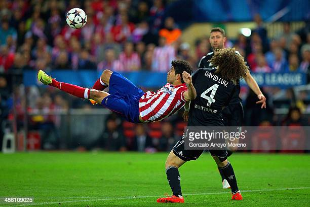 Diego Costa of Club Atletico de Madrid kicks the ball under pressure from David Luiz of Chelsea during the UEFA Champions League Semi Final first leg...