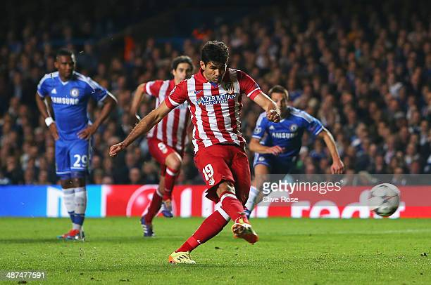 Diego Costa of Club Atletico de Madrid scores from the penalty spot during the UEFA Champions League semi-final second leg match between Chelsea and...