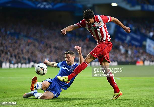 Diego Costa of Club Atletico de Madrid shoots at goal under a challenge by Gary Cahill of Chelsea during the UEFA Champions League semifinal second...