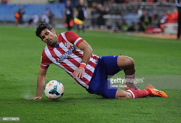 Diego Costa of Club Atletico de Madrid takes a fall during the La Liga match between Club Atletico de Madrid and Granada CF at Vicente Calderon...
