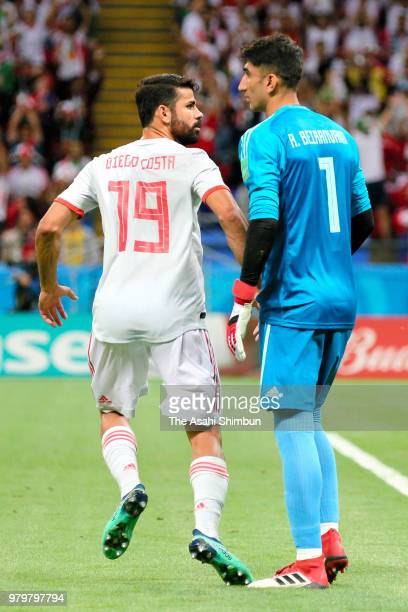Diego Costa of Spain and Ali Beiranvand of Iran exchange words during the 2018 FIFA World Cup Russia Group B match between Iran and Spain at Kazan...