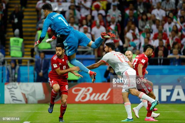 Diego Costa of Spain and Alireza Beiranvand of Iran battle for the ball during the 2018 FIFA World Cup Russia group B match between Iran and Spain at...
