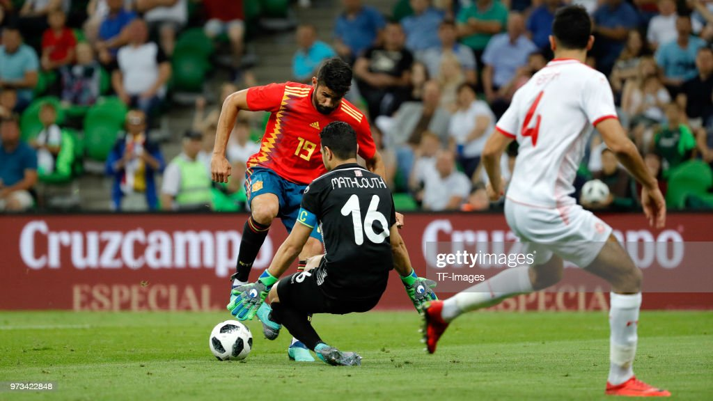 Diego Costa of Spain and Balbouli of Tunisia battle for the ball during the friendly match between Spain and Tunisia at Krasnodar's stadium on June 9, 2018 in Krasnodar, Russia.