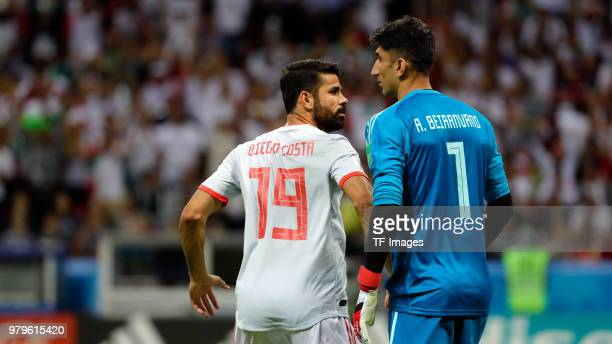 Diego Costa of Spain and Goalkeeper Alireza Beiranvand of Iran look on during the 2018 FIFA World Cup Russia group B match between Iran and Spain at...