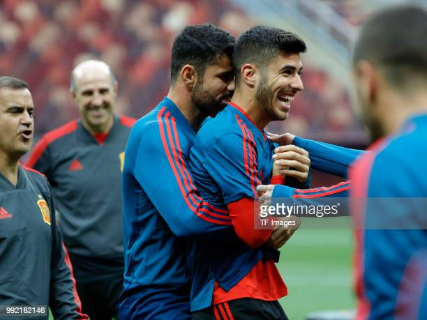 Diego Costa of Spain and Marco Asensio of Spain laugh during a training session on June 30 2018 in Moscow Russia