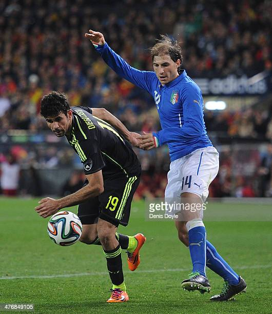 Diego Costa of Spain battles for the ball against Gabriel Paletta of Italy during the international friendly match between Spain and Italy on March 5...
