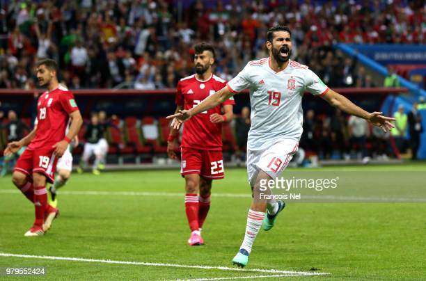Saeid Ezatolahi of Iran scores a goal that will be disallowed due to offside past David de Gea of Spain during the 2018 FIFA World Cup Russia group B...