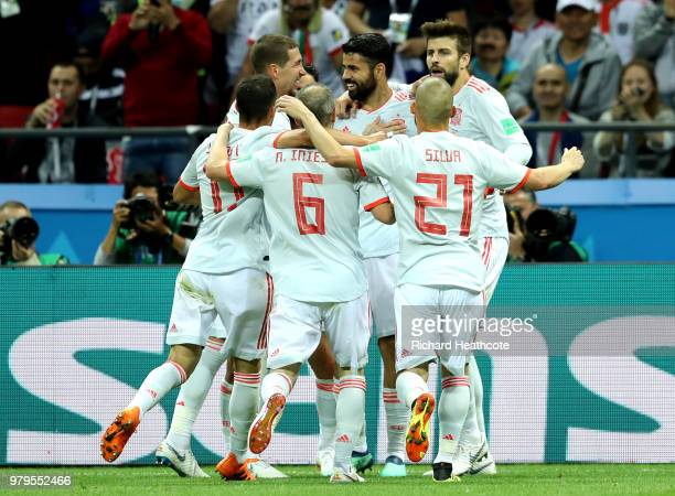Diego Costa of Spain celebrates after scoring his team's first goal with team mates during the 2018 FIFA World Cup Russia group B match between Iran...