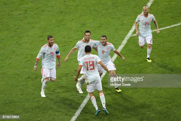 Diego Costa of Spain celebrates after scoring his team's second goal with team mates during the 2018 FIFA World Cup Russia group B match between...