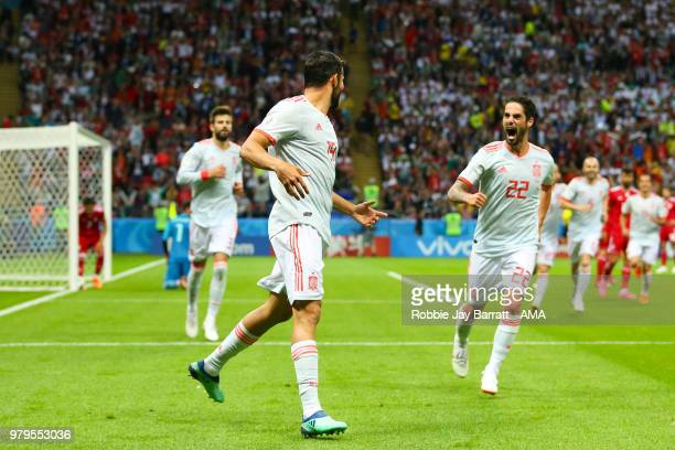 Diego Costa of Spain celebrates scoring a goal to make it 0-1 with Isco during the 2018 FIFA World Cup Russia group B match between Iran and Spain at...