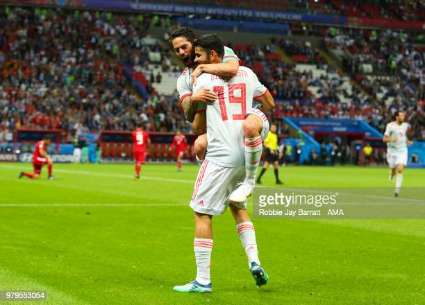 Diego Costa of Spain celebrates scoring a goal to make it 01 with Isco during the 2018 FIFA World Cup Russia group B match between Iran and Spain at...