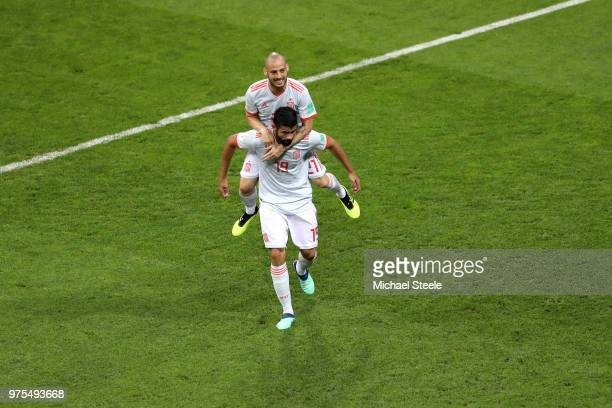 Diego Costa of Spain celebrates with team mate David Silva after scoring his team's first goal during the 2018 FIFA World Cup Russia group B match...