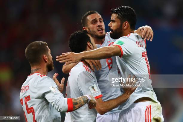 Diego Costa of Spain celebrates with team mates after scoring his team's second goal during the 2018 FIFA World Cup Russia group B match between...