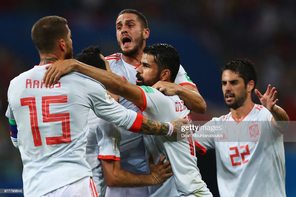 Diego Costa (R) of Spain celebrates with team mates after scoring his team's second goal during the 2018 FIFA World Cup Russia group B match between Portugal and Spain at Fisht Stadium on June 15, 2018 in Sochi, Russia.