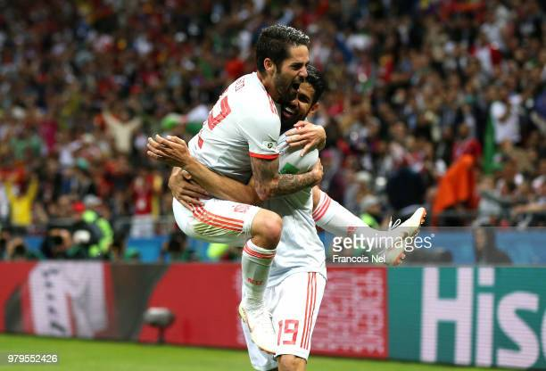 Diego Costa of Spain celebrates with teammate Isco after scoring his team's first goal during the 2018 FIFA World Cup Russia group B match between...
