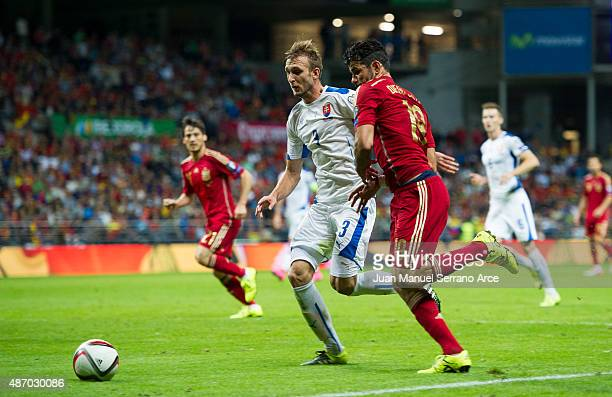 Diego Costa of Spain duels for the ball with Norbert Gyomber of Slovakia during the Spain v Slovakia EURO 2016 Qualifier at Carlos Tartiere on...