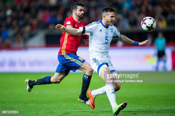 Diego Costa of Spain duels for the ball with Rami Gershon of Israel during the FIFA 2018 World Cup Qualifier between Spain and Israel at Estadio El...