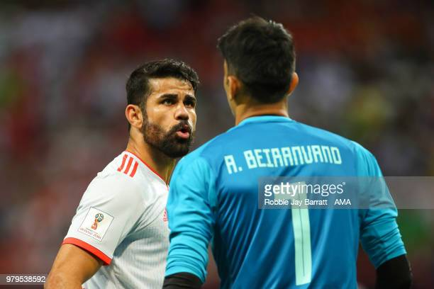Diego Costa of Spain exchanges words with Ali Beiranvand of IR Iran during the 2018 FIFA World Cup Russia group B match between Iran and Spain at...