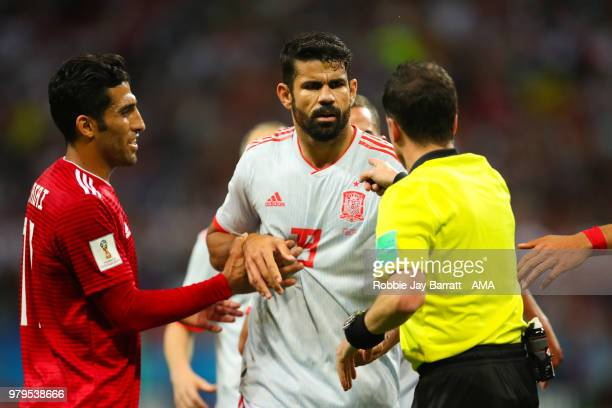 Diego Costa of Spain exchanges words with Referee Andres Cunha during the 2018 FIFA World Cup Russia group B match between Iran and Spain at Kazan...