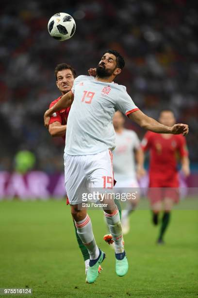 Diego Costa of Spain is challenged by Cedric of Portugal during the 2018 FIFA World Cup Russia group B match between Portugal and Spain at Fisht...