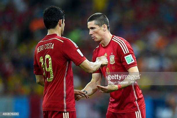 Diego Costa of Spain is replaced by Fernando Torres during the 2014 FIFA World Cup Brazil Group B match between Spain and Chile at Estadio Maracana...