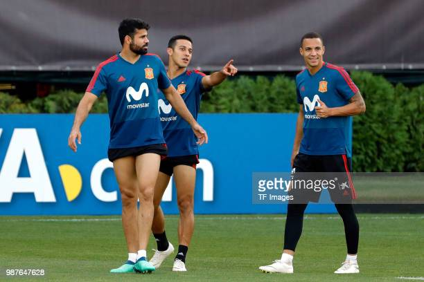 Diego Costa of Spain looks on and Thiago Alcantara of Spain gestures and Rodrigo Moreno of Spain laughs during a training session on June 27 2018 in...
