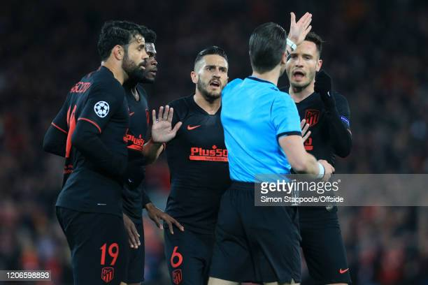 Diego Costa Thomas Koke and Saul Niguez of Atletico argue with referee Danny Makkelie during the UEFA Champions League round of 16 second leg match...