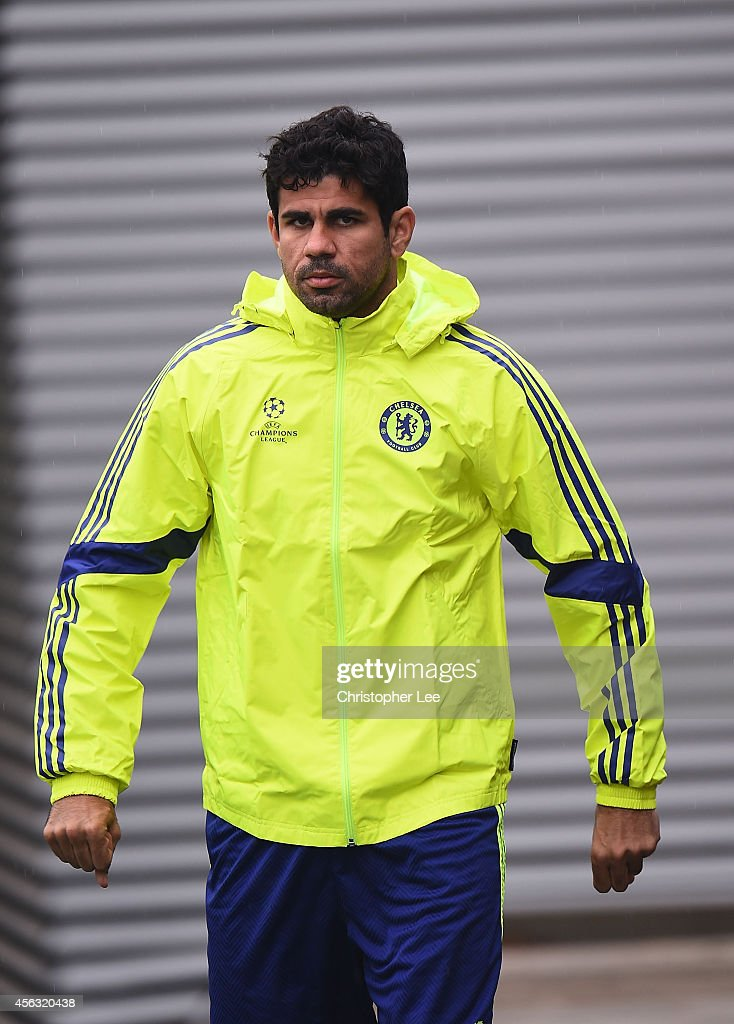 Diego Costa walks out onto the pitch during the Chelsea Training Session at Chelsea Training Ground on September 29, 2014 in Cobham, England.