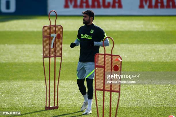 Diego Costa warms up during the Atletico de Madrid training session for the UEFA CHampions League football match to play against Lokomotiv of Moscow,...