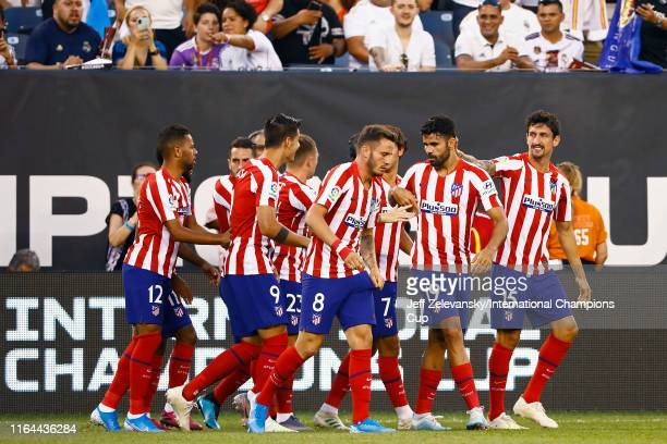 Diego Da Silva Costa of Atletico Madrid is congratulated by his teammates after scoring a goal in the first minute of the game against Real Madrid...
