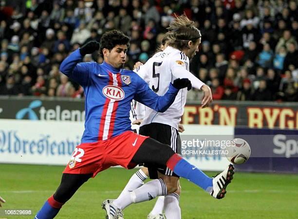 Diego da Silva Costa of Atletico Madrid vies against Mattias Bjarsmyr of Rosenborg during their UEFA Europa League match at Lerkendal Stadium in...