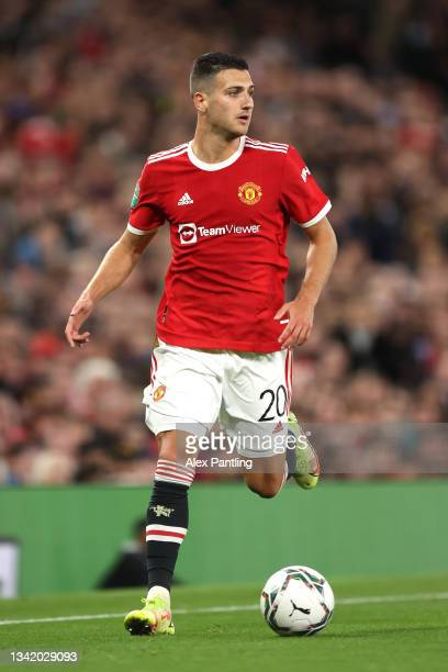 Diego Dalot of Manchester United runs with the ball during the Carabao Cup Third Round match between Manchester United and West Ham United at Old...
