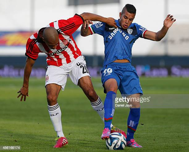 Diego Daniel Vera of Estudiantes and Lucas Romero of Velez Sarsfield vies for the ball during a match between Estudiantes and Velez Sarsfield as part...