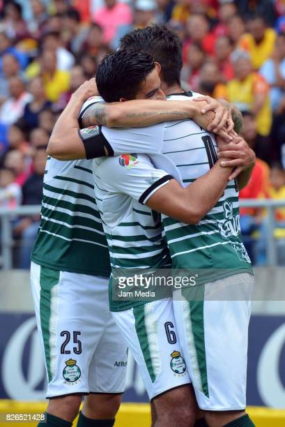 Diego de Buen of Santos celebrates with teammates after scoring the first goal of his team during the 3rd round match between Morelia and Santos as...