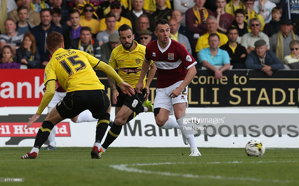 Diego De Girolamo of Northampton Town plays the ball past Tom Naylor of Burton Albion during the Sky Bet League Two match between Burton Albion and Northampton Town at Pirelli Stadium on April 25, 2015 in Burton-upon-Trent, England.