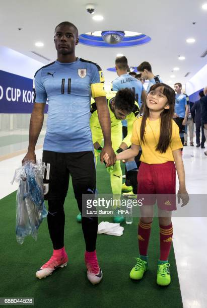 Diego de la Cruz of Uruguay is seen with the players mascot during the FIFA U20 World Cup Korea Republic 2017 group D match between Uruguay and Japan...
