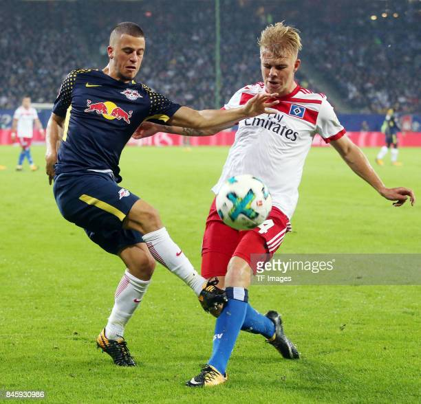 Diego Demme of Leipzig and Rick van Drongelen battle for the ball during the Bundesliga match between Hamburger SV and RB Leipzig at Volksparkstadion...