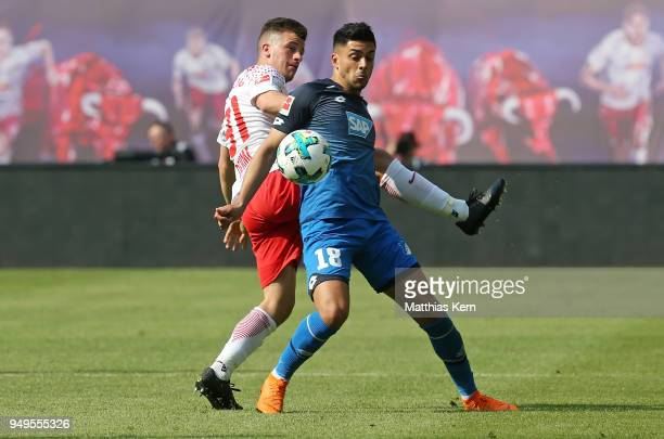 Diego Demme of Leipzig battles for the ball with Nadiem Amiri of Hoffenheim during the Bundesliga match between RB Leipzig and TSG 1899 Hoffenheim at...