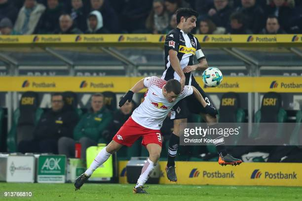 Diego Demme of Leipzig fights for the ball with Lars Stindl of Moenchengladbach during the Bundesliga match between Borussia Moenchengladbach and RB...