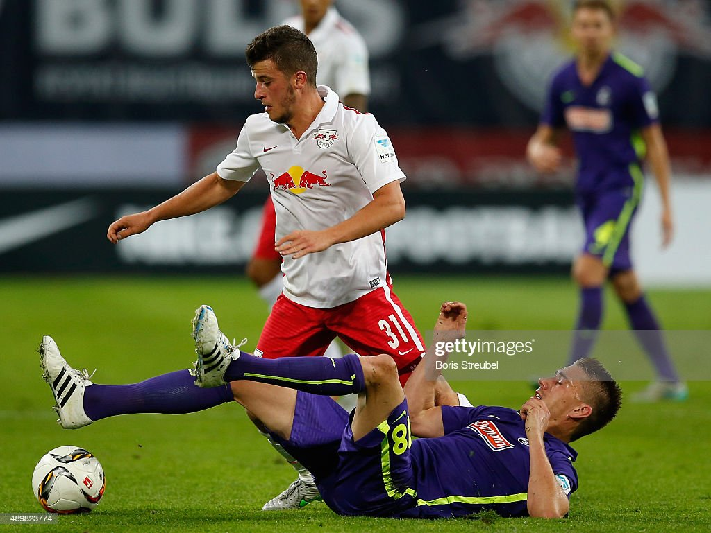 Diego Demme (L) of Leipzig is tackled by Nils Petersen of Freiburg during the Second Bundesliga match between RB Leipzig and SC Freiburg at Red Bull Arena on September 24, 2015 in Leipzig, Germany.