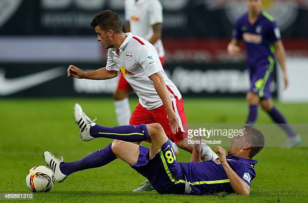 Diego Demme of Leipzig is tackled by Nils Petersen of Freiburg during the Second Bundesliga match between RB Leipzig and SC Freiburg at Red Bull...